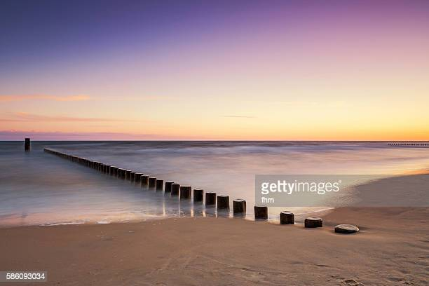 Groynes on the beach in a very nice colorful sunset