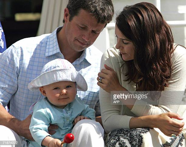Denmark's Crown Prince Frederik and wife Mary look at their son Christian during a photoshoot on the steps of Grsten Castle 03 August 2006 AFP...