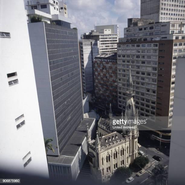 A Gruenderzeit corner building vanishes in the city jungle of Belo Horizonte Brazil early 1990s