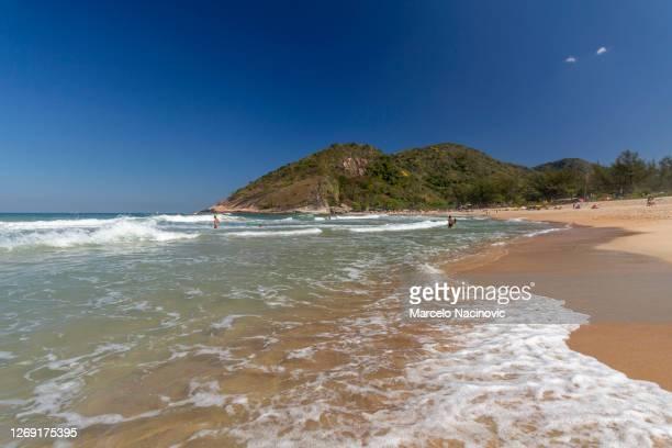 grumari beach in rio de janeiro - marcelo nacinovic stock pictures, royalty-free photos & images