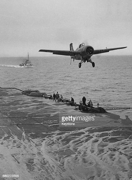 Grumman F4F Martlet of Fleet Air Arm 881 Naval Air Squadron landing on the flight deck of the Royal Navy Illustrious-class aircraft carrier HMS...