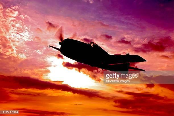 A Grumman F6F Hellcat fighter plane in flight over Chino, California.