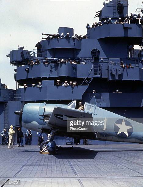 A Grumman F6F3 Hellcat fighter plane waits for takeoff on the flight deck of the aircraft carrier USS Yorktown May 1943