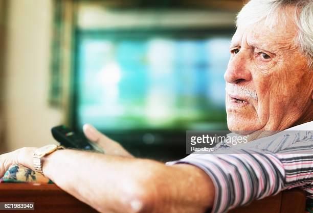 Grumpy 90-yer-old man disturbed while watching TV