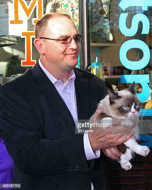 Grumpy Cat and Bryan Bundesen arrive at The Grumpy Guide To Life Observations By Grumpy Cat Book Launch Party at Kitson on August 4 2014 in Santa...