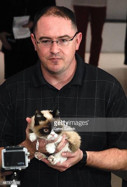 Grumpy Cat and Bryan Bundesen attend Grumpy Cat's Grumpiest Birthday Bash at 404 10th Avenue on April 29 2014 in New York City