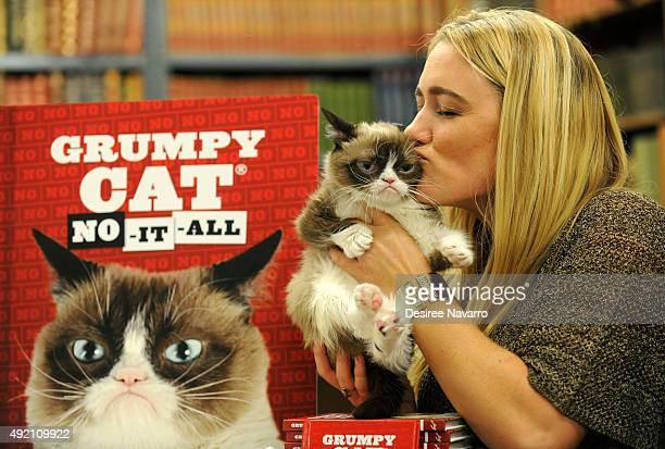 Grumpy Cat and owner Tabatha Bundesen attend the premiere of her latest book NoItAll Everything You Need To No at Strand Bookstore on October 9 2015...