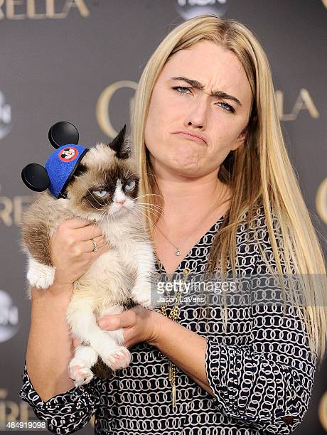Grumpy Cat and Tabatha Bundesen attend the premiere of Cinderella at the El Capitan Theatre on March 1 2015 in Hollywood California
