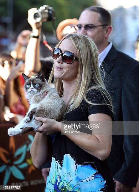 Grumpy Cat Bryan Bundesen and Tabatha Bundesen arrive at The Grumpy Guide To Life Observations By Grumpy Cat Book Launch Party at Kitson on August 4...