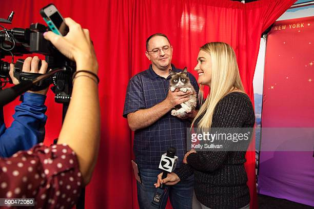 Grumpy Cat is interviewed with owner Tabatha Bundesen and Tabatha's brother Bryan at Madame Tussauds San Francisco on December 8 2015 in San...
