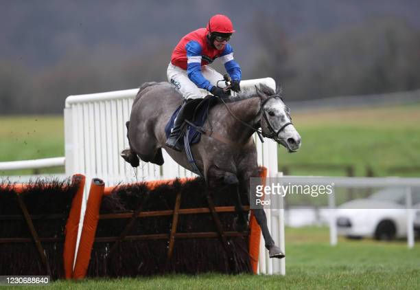 Grumpy Charley ridden by Bryan Carver jumps the last prior to winning the Providers Of Man Power Silvershine Novices' Hurdle at Chepstow Racecourse...