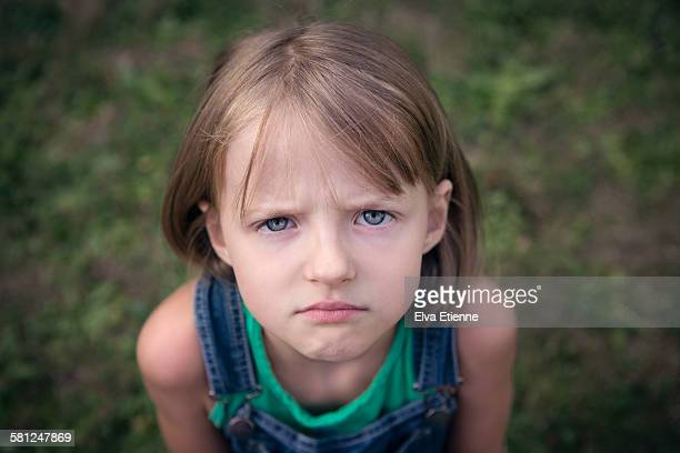 grumpy child - sulking stock pictures, royalty-free photos & images