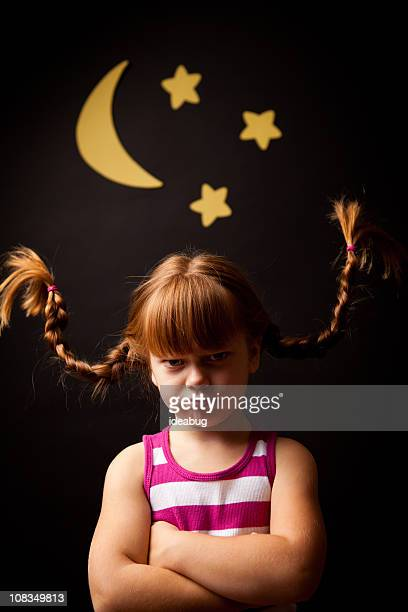 Grumpy Girl with Upward Braids Standing Under Moon and Stars