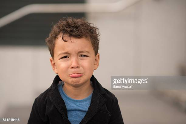 grumpy little boy - sulking stock pictures, royalty-free photos & images