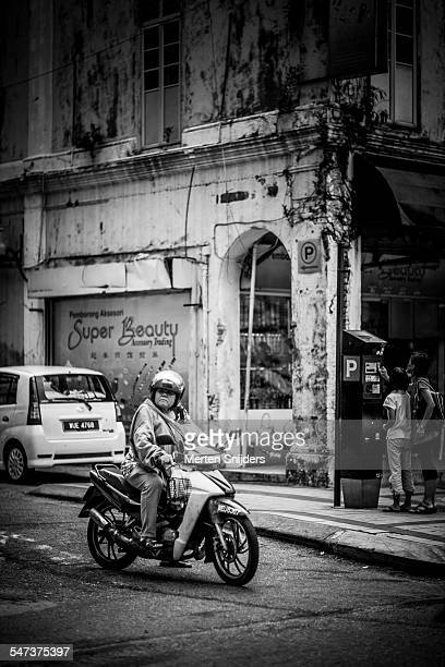 grumpy looking woman on motorbike - women black and white motorcycle stock pictures, royalty-free photos & images