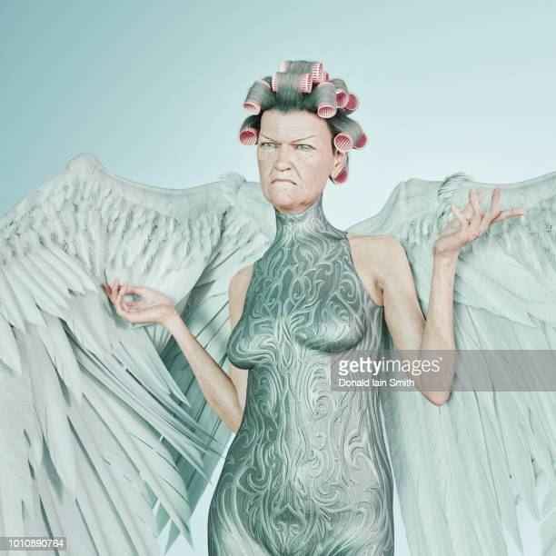 Grumpy mature angel with hair curlers and body suit