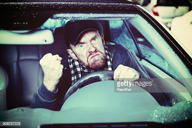 Grumpy old man! Angry driver shakes his fist
