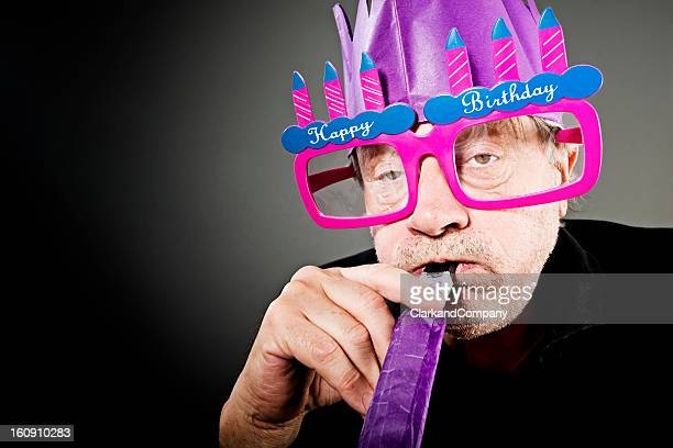 grumpy old man celebrating another birthday - grumpy old man stock pictures, royalty-free photos & images