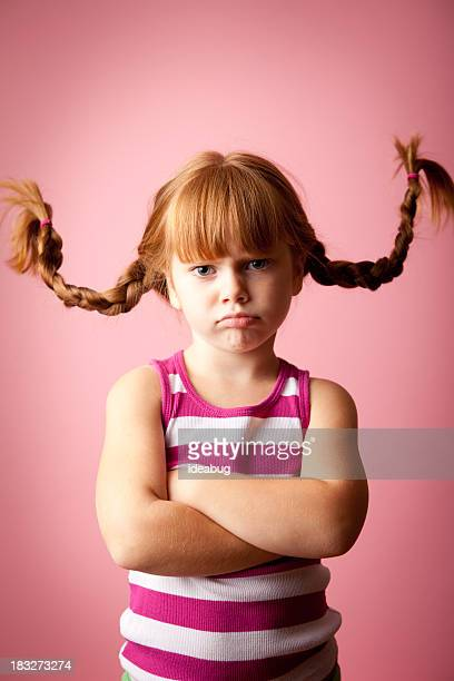 Grumpy Red-Haired Girl Standing with Upward Braids, Arms Crossed