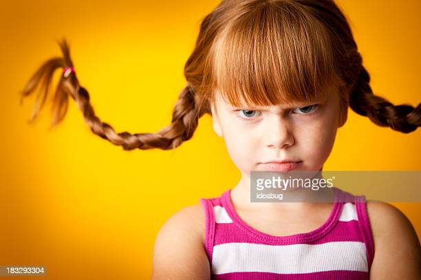 Grumpy Red-Haired Girl with Upward Braids and a Scowl