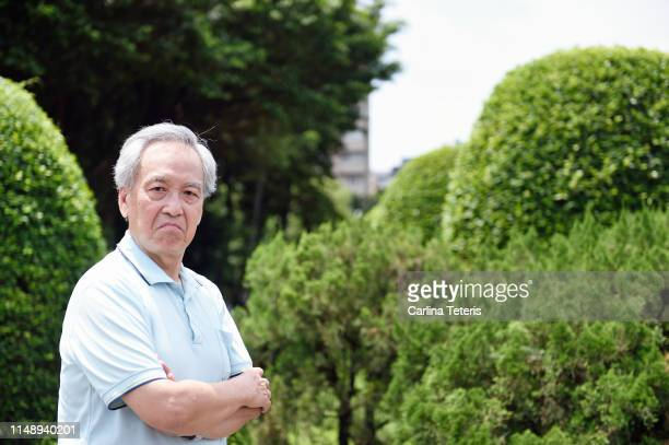 grumpy senior man - sulking stock pictures, royalty-free photos & images