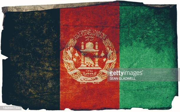 grunge afghani flag poster - insignia stock pictures, royalty-free photos & images