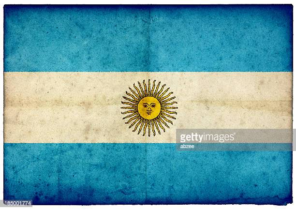 Grunge Argentinian Flag on rough edged old postcard