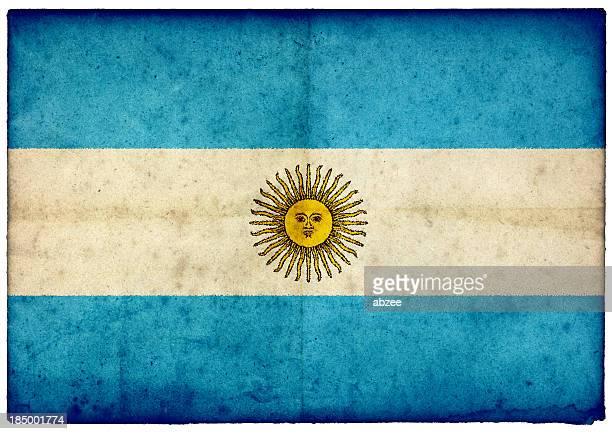 Grunge de bandera argentina en Violento borde de la antigua tarjeta postal