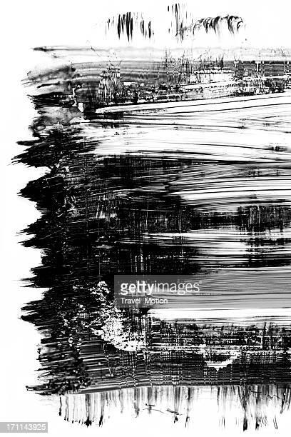 Grunge black paint brush stroke isolated on white