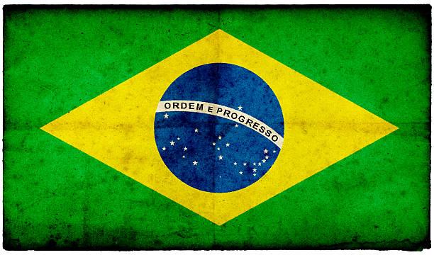 Grunge Brazilian Flag on rough edged old postcard