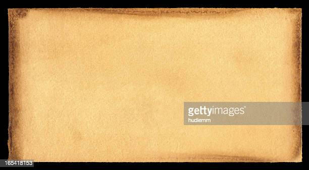 grunge brown paper textured background - old parchment background burnt stock photos and pictures