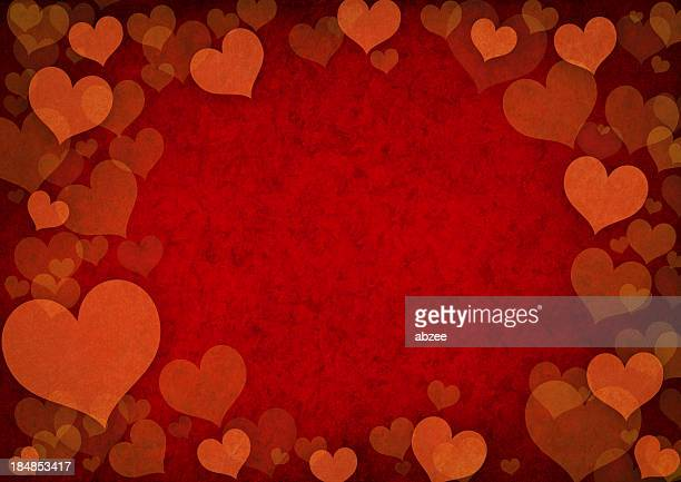 Grunge effect background of red heart shapes