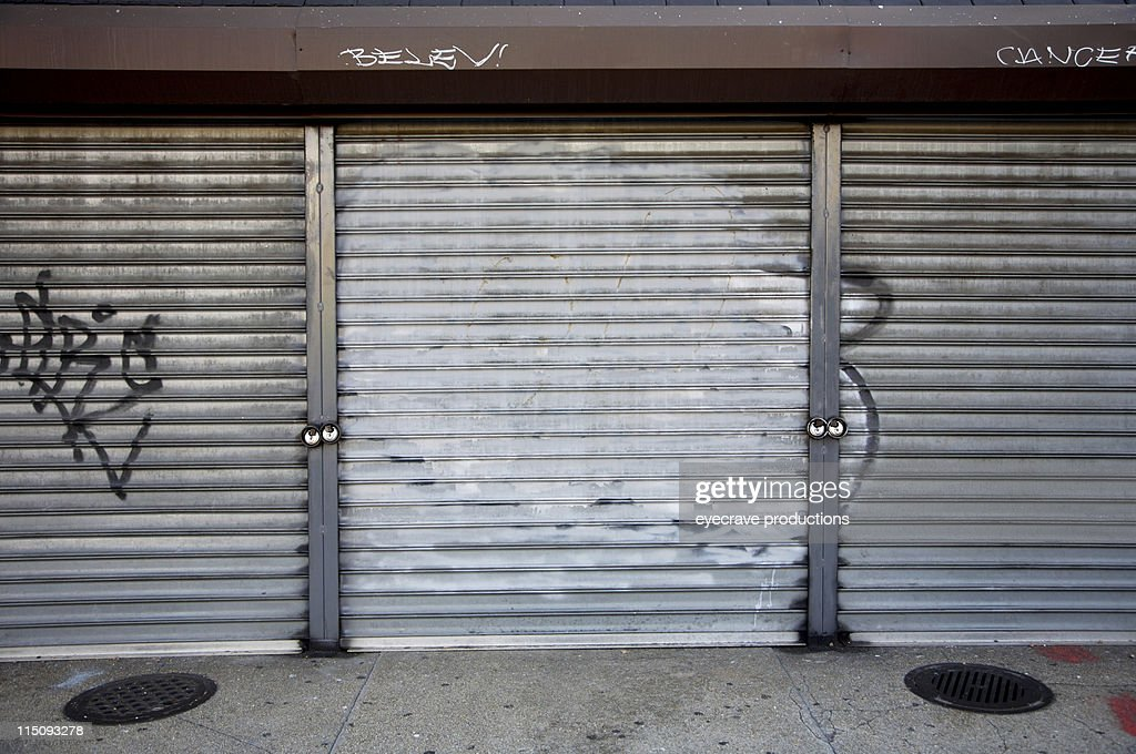 Grunge Garage Doors In Urban Setting Stock Photo Getty Images
