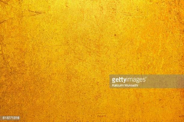 Grunge golden wall texture background
