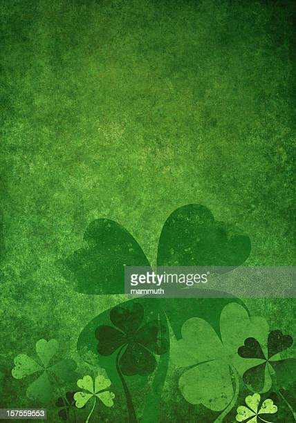 grunge green background with four leaf clovers - st patricks stock pictures, royalty-free photos & images