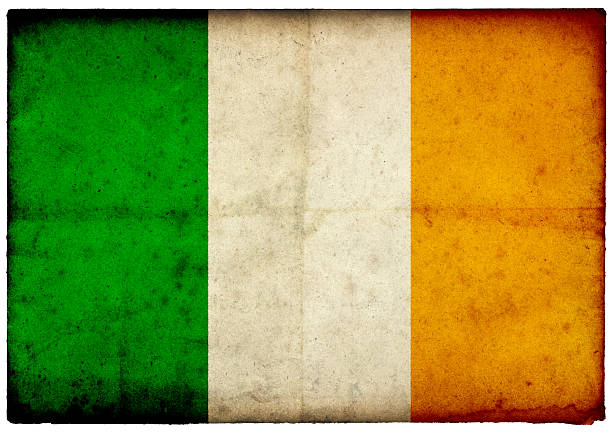 Grunge Irish Flag on rough edged old postcard