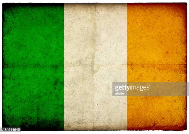 grunge irish flag on rough edged old postcard - irish flag stock pictures, royalty-free photos & images