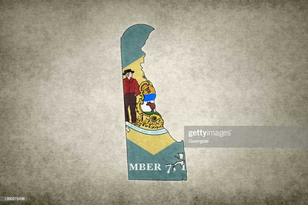 Grunge map of the state of Delaware with its flag printed within : Stock Photo