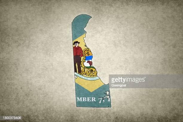 grunge map of the state of delaware with its flag printed within - gwengoat stock pictures, royalty-free photos & images