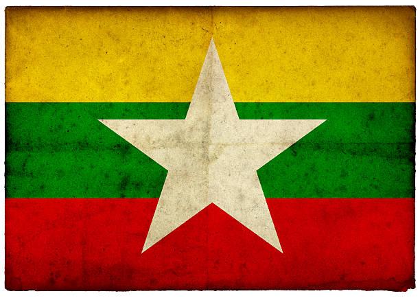 Grunge Myanmar Flag on rough edged old postcard