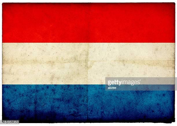Grunge Netherlands Flag on rough edged old postcard