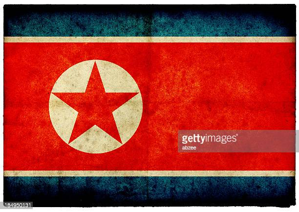 Grunge North Korean Flag on rough edged old postcard
