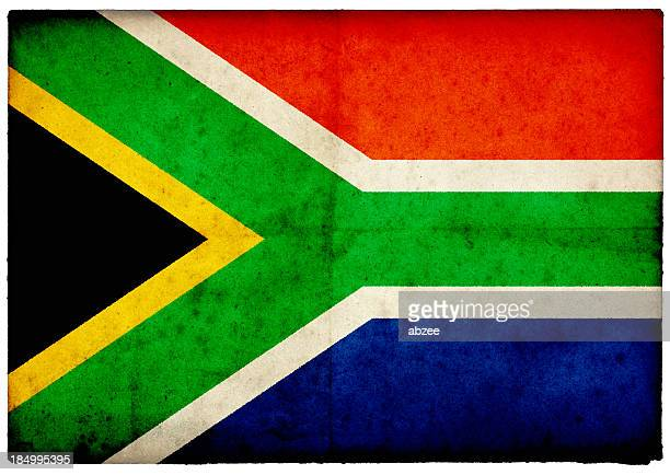 grunge south african flag on rough edged old postcard - south african flag stock photos and pictures