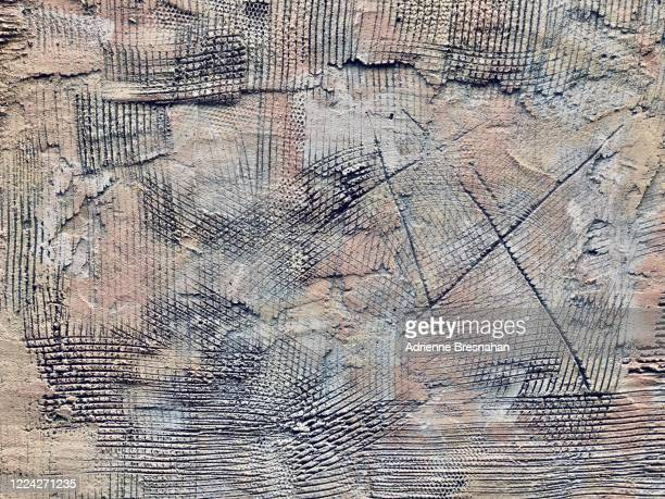 grunge stucco wall with two x's - etching stock pictures, royalty-free photos & images