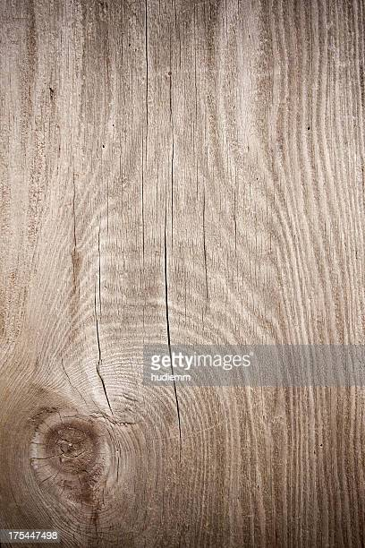 Grunge wood textured background with knot
