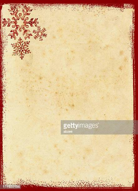 Grungey red snowflakes on old paper background