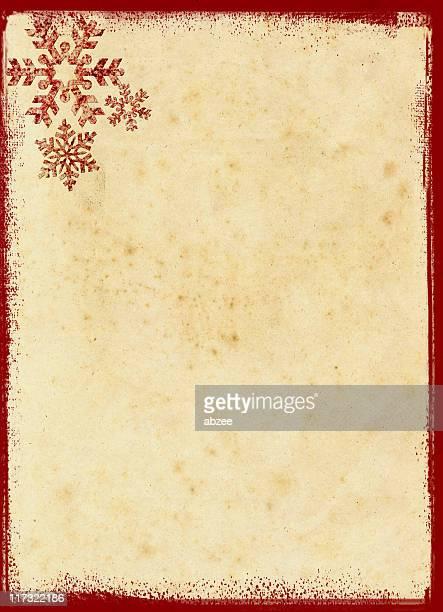 Grungey flocons de neige rouge sur vieux fond de papier