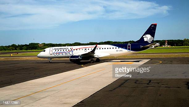 A Grupo Aeromexico SAB Embraer ERJ190100IGW 190AR plane taxis down the runway at the Comalapa International Airport in Comalapa El Salvador on...