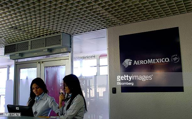 Grupo Aeromexico SAB employees work at the Comalapa International Airport in Comalapa El Salvador on Tuesday July 3 2012 Grupo Aeromexico SAB...