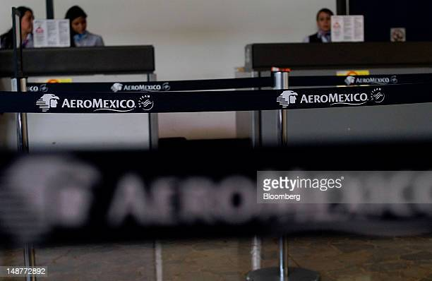 Grupo Aeromexico SAB signage is displayed on a partition at the Comalapa International Airport in Comalapa El Salvador on Tuesday July 3 2012 Grupo...